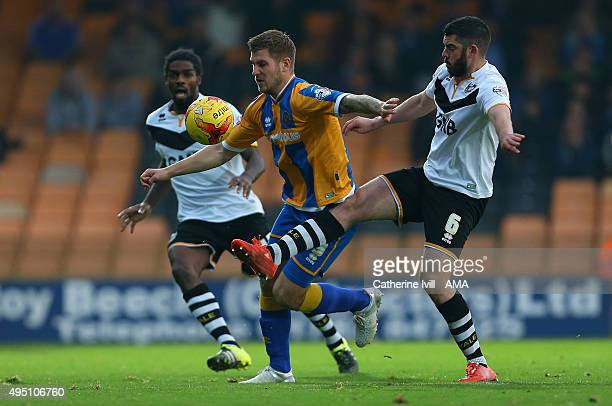 James Collins of Shrewsbury Town battles with Richard Duffy of Port Vale during the Sky Bet League One match between Port Vale and Shrewsbury Town at...