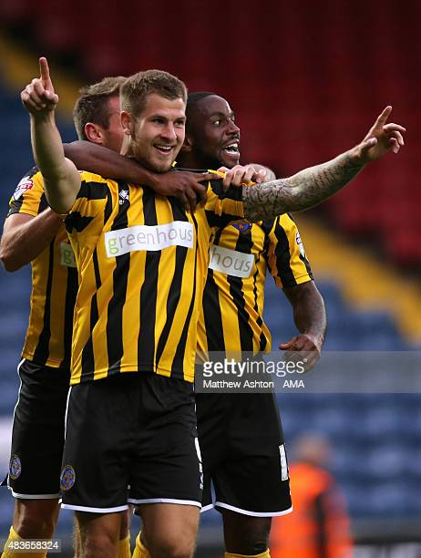 James Collins of Shrewsbury Town celebrates after scoring a goal to make it 01 during the Capital One Cup First Round match between Blackburn Rovers...