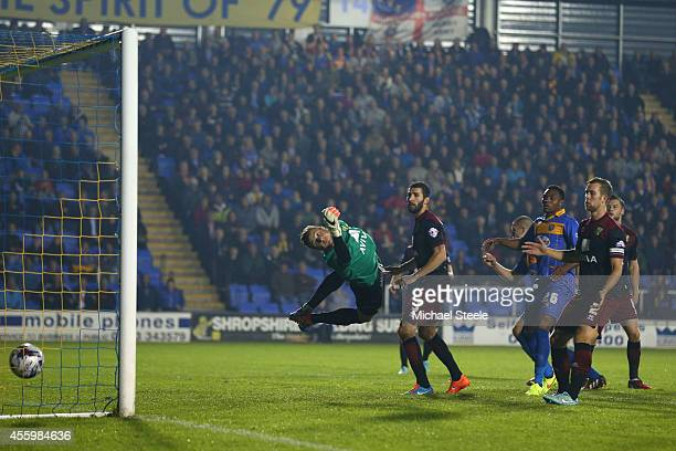 James Collins of Shrewsbury Town scores the opening goal during the Capital One Cup Third Round match between Shrewsbury Town and Norwich City at...