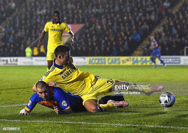 James Collins of Shrewsbury Town tussles with Gary Cahill of Chelsea during the Capital One Cup Fourth Round match between Shrewsbury Town and...