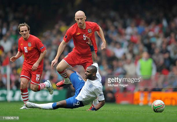 James Collins of Wales challenges Darren Bent of England during the UEFA EURO 2012 Group G qualifying match between Wales and England at the...