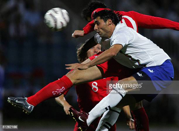 James Collins of Wales jumps with Mahir Shukvrov of Azerbaijan to head the ball during the FIFA World Cup Group Six Qualifying match played at the...