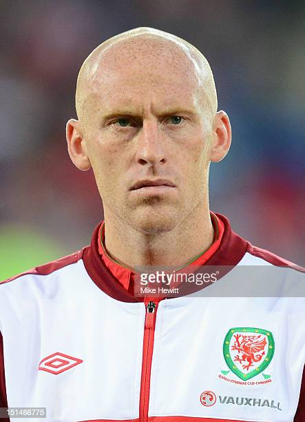 James Collins of Wales lines up for the National Anthems prior to the FIFA 2014 World Cup Group A Qualifier between Wales and Belgium at Cardiff City...