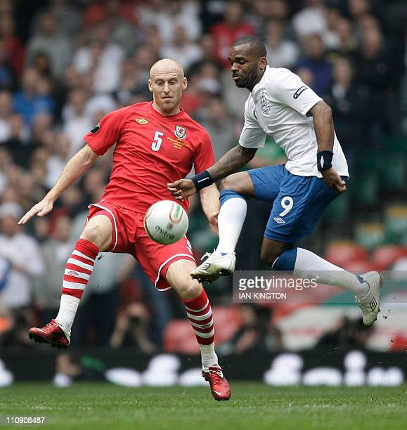 James Collins of Wales vies with England's Darren Bent during a Euro 2012 Group G qualifying football match at the Millenium Stadium Cardiff Wales on...