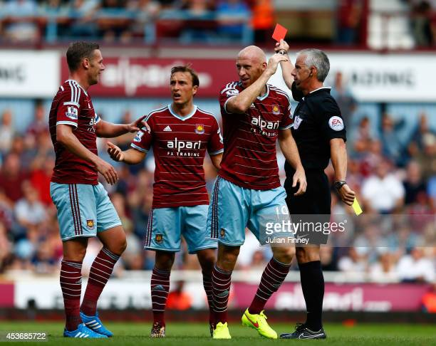 James Collins of West Ham reacts after receiving the red card for his second bookable offence during the Barclays Premier League match between West...