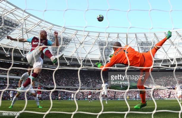 James Collins of West Ham Unitd clears the ball during the Premier League match between West Ham United and Swansea City at London Stadium on April 8...