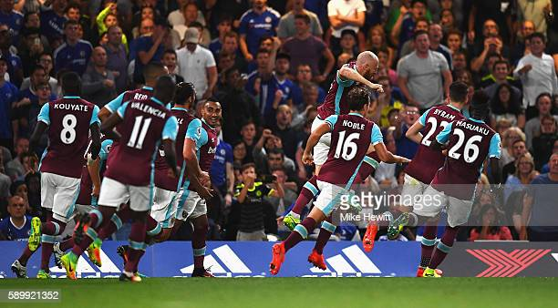 James Collins of West Ham United celebrates scoring his team's opening goal during the Premier League match between Chelsea and West Ham United at...
