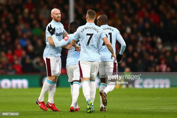 James Collins of West Ham United celebrates with teammates after scoring his sides first goal during the Premier League match between AFC Bournemouth...