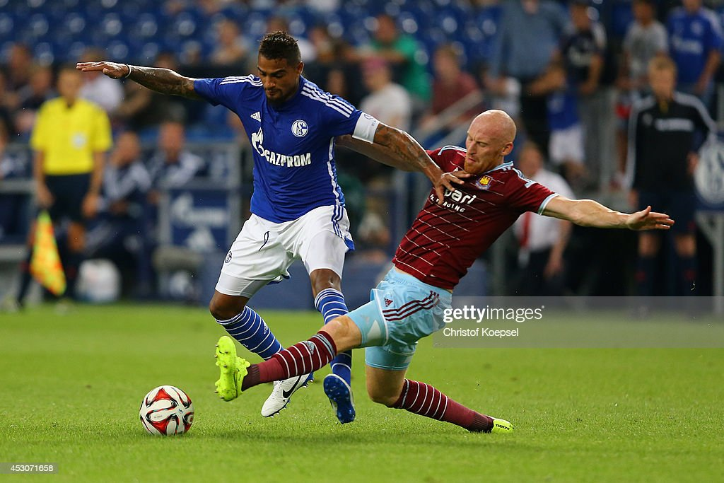 James Collins of West Ham United (R) challenges Kevin-Prince Boateng of Schalke (L) during the match between FC Schalke 04 and West Ham United as part of the Schalke 04 Cup Day at Veltins-Arena on August 2, 2014 in Gelsenkirchen, Germany.