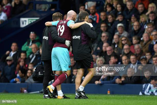 James Collins of West Ham United goes off injured during the Premier League match between West Bromwich Albion and West Ham United at The Hawthorns...