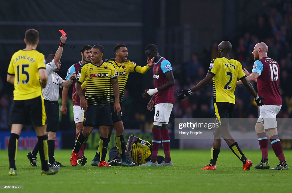 James Collins (1st R) of West Ham United is shown a red card by referee Keith Stroud (2nd L) during the Barclays Premier League match between Watford and West Ham United at Vicarage Road on October 31, 2015 in Watford, England.