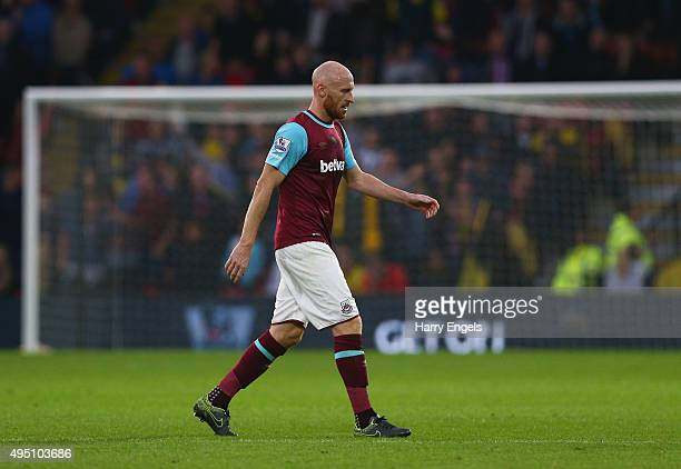 James Collins of West Ham United leaves the pitch after being shown a red card during the Barclays Premier League match between Watford and West Ham...