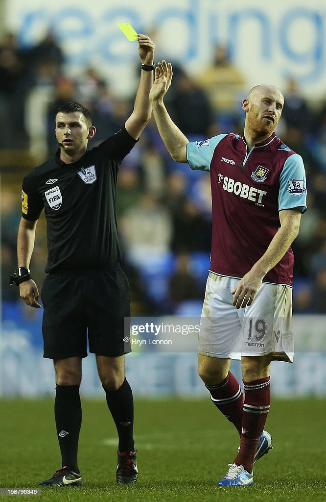 James Collins of West Ham United reacts to receiving a yellow card from referee Michael Oliver during the Barclays Premier League match between Reading and West Ham United at the Madejski Stadium on December 29, 2012 in Reading, England.