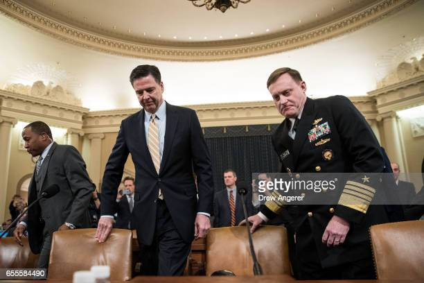 James Comey Director of the Federal Bureau of Investigation and Michael Rogers Director of the National Security Agency arrive for a House Permanent...