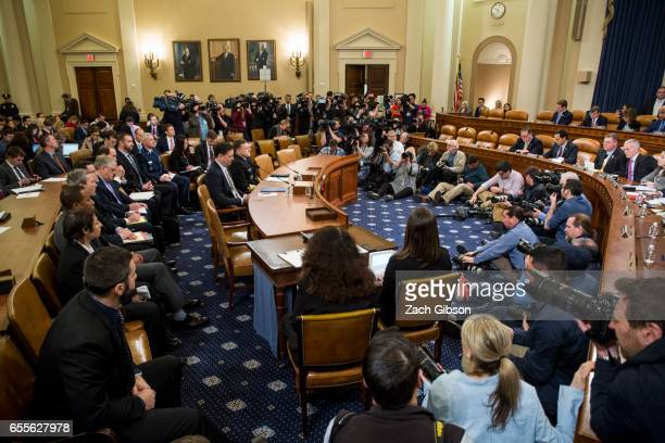 James Comey Director of the Federal Bureau of Investigation and Michael Rogers Director of the National Security Agency are pictured at the start of...