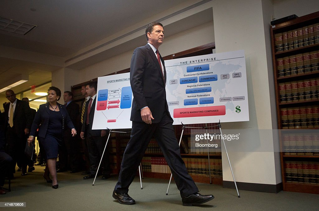 James Comey, director of the Federal Bureau of Investigation (FBI), center, and Loretta Lynch, U.S. attorney general, left, arrive for a news conference in the Brooklyn borough of New York, U.S., on Wednesday, May 27, 2015. The future of the World Cup has been called into question and soccer's governing body plunged into crisis after U.S. prosecutors charged nine officials with corruption and Switzerland probed upcoming tournaments awarded to Russia and Qatar. Photographer: Victor J. Blue/Bloomberg via Getty Images