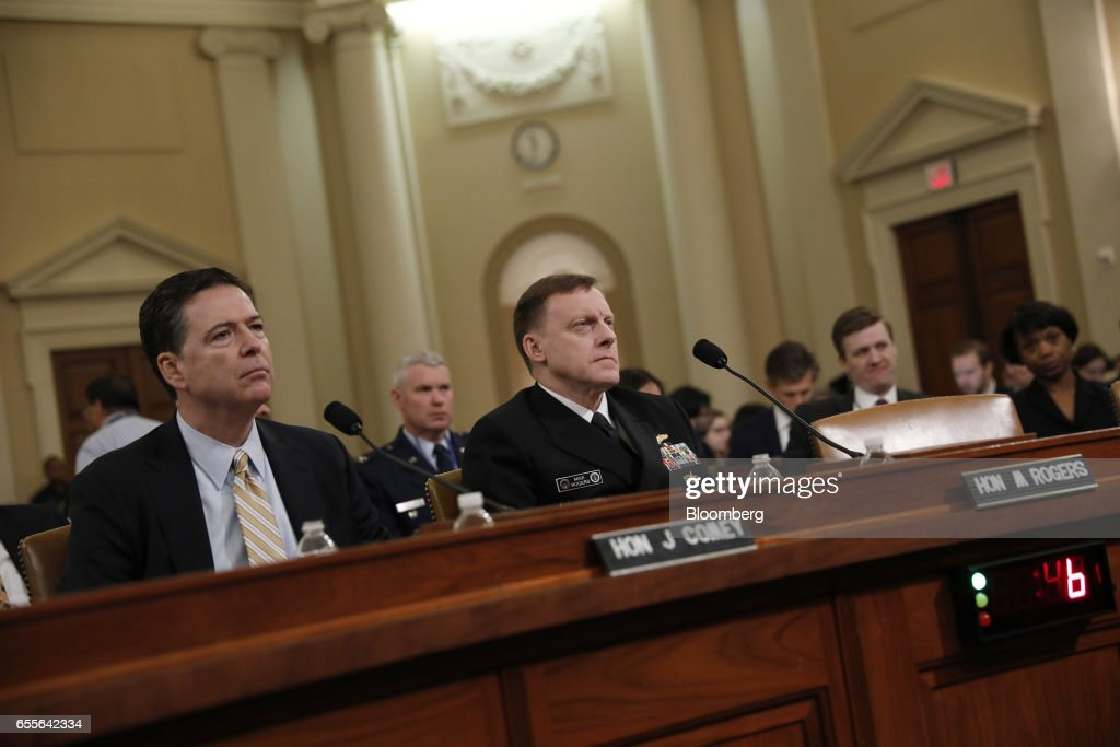 James Comey, director of the Federal Bureau of Investigation (FBI), left, and Michael Rogers, director of the U.S. National Security Agency (NSA), listen during a House Intelligence Committee hearing in Washington, D.C., U.S., on Monday, March 20, 2017. Comey confirmed that the bureau isinvestigating potential ties between associates of President Donald Trump and Russia during the 2016 campaign as part of a broader look into Moscow's efforts to interfere in the election. Photographer: Aaron P. Bernstein/Bloomberg via Getty Images