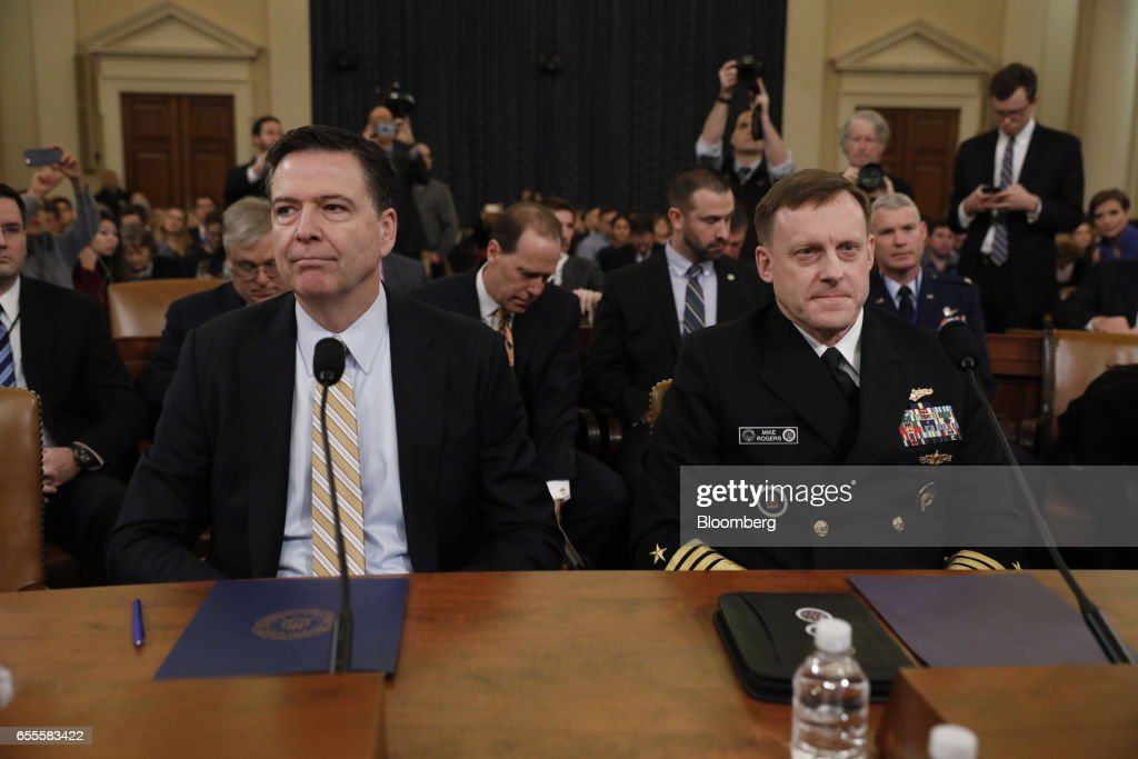 James Comey, director of the Federal Bureau of Investigation (FBI), left, awaits the beginning of a House Intelligence Committee hearing in Washington, D.C., U.S., on Monday, March 20, 2017. Comey on Monday will testify publicly for the first timesince Trumps inauguration about Russias meddling in the U.S. presidential election and the web of conspiracies -- or conspiracy theories -- entangling Trump and those close to him. Photographer: Aaron P. Bernstein/Bloomberg via Getty Images