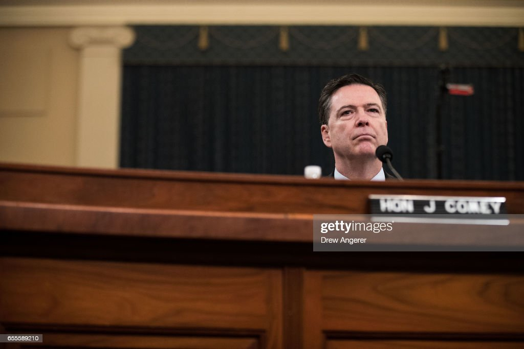 James Comey, Director of the Federal Bureau of Investigation (FBI), listens to opening statements from the chairman during a House Permanent Select Committee on Intelligence hearing concerning Russian meddling in the 2016 United States election, on Capitol Hill, March 20, 2017 in Washington, DC. While both the Senate and House Intelligence committees have received private intelligence briefings in recent months, Monday's hearing is the first public hearing on alleged Russian attempts to interfere in the 2016 election.