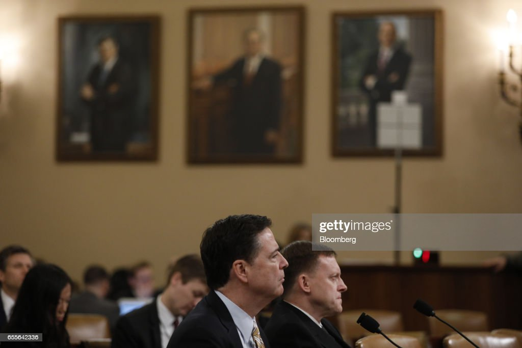 James Comey, director of the Federal Bureau of Investigation (FBI), listens during a House Intelligence Committee hearing in Washington, D.C., U.S., on Monday, March 20, 2017. Comey confirmed that the bureau isinvestigating potential ties between associates of President Donald Trump and Russia during the 2016 campaign as part of a broader look into Moscow's efforts to interfere in the election. Photographer: Aaron P. Bernstein/Bloomberg via Getty Images