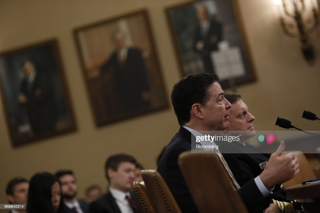 James Comey, director of the Federal Bureau of Investigation (FBI), speaks during a House Intelligence Committee hearing in Washington, D.C., U.S., on Monday, March 20, 2017. Comey confirmed that the bureau isinvestigating potential ties between associates of President Donald Trump and Russia during the 2016 campaign as part of a broader look into Moscow's efforts to interfere in the election. Photographer: Aaron P. Bernstein/Bloomberg via Getty Images