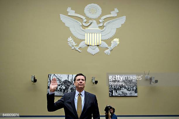 James Comey director of the Federal Bureau of Investigation swears in to a House Oversight and Government Reform Committee hearing in Washington DC...