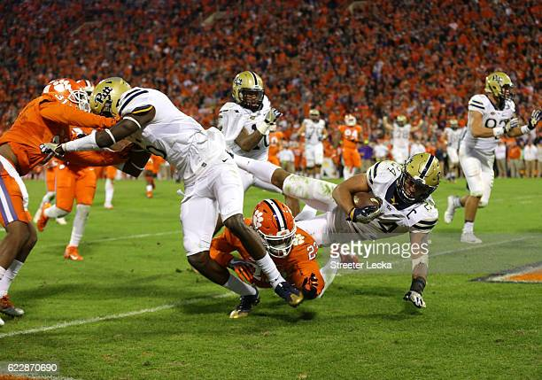 James Conner of the Pittsburgh Panthers runs for a touchdown against Van Smith of the Clemson Tigers during their game at Memorial Stadium on...