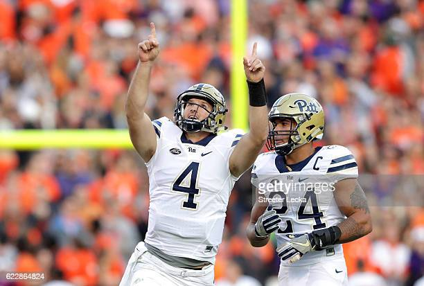 James Conner of the Pittsburgh Panthers watches as teammate Nathan Peterman celebrates after a touchdown pass against the Clemson Tigers during their...