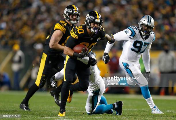 James Conner of the Pittsburgh Steelers carries the ball against the Carolina Panthers during the first half in the game at Heinz Field on November 8...