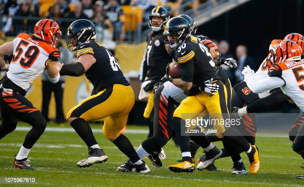 James Conner of the Pittsburgh Steelers carries the ball against the Cincinnati Bengals in the first quarter during the game at Heinz Field on...