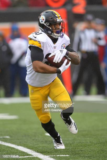 James Conner of the Pittsburgh Steelers carries the ball during the first quarter of the game against the Cincinnati Bengals at Paul Brown Stadium on...