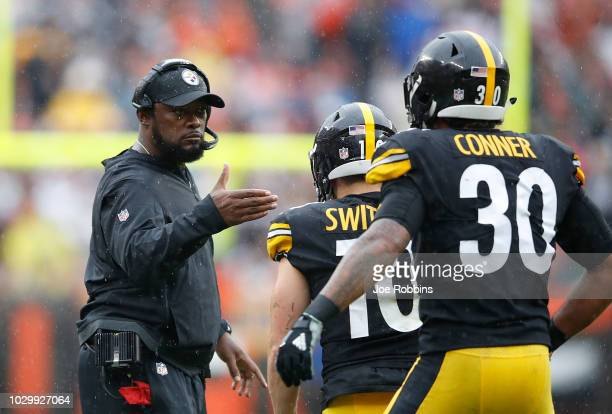James Conner of the Pittsburgh Steelers celebrates his touchdown with head coach Mike Tomlin during the second quarter against the Cleveland Browns...