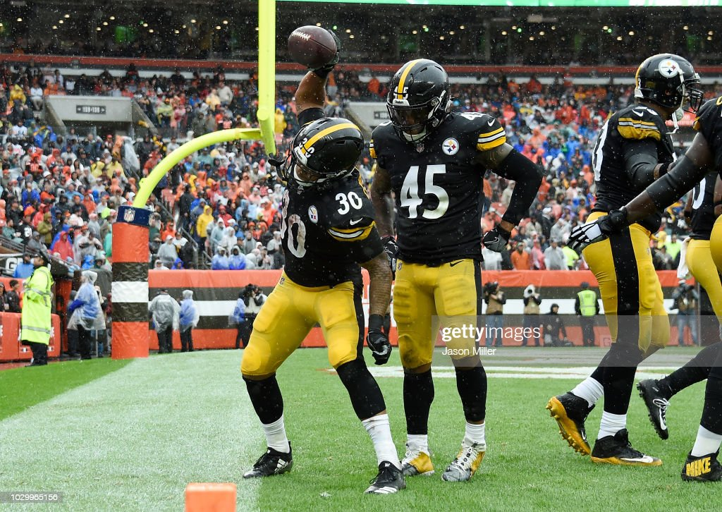 James Conner #30 of the Pittsburgh Steelers celebrates his touchdown with Roosevelt Nix-Jones #45 during the third quarter against the Cleveland Browns at FirstEnergy Stadium on September 9, 2018 in Cleveland, Ohio.