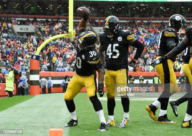 James Conner of the Pittsburgh Steelers celebrates his touchdown with Roosevelt Nix-Jones during the third quarter against the Cleveland Browns at...