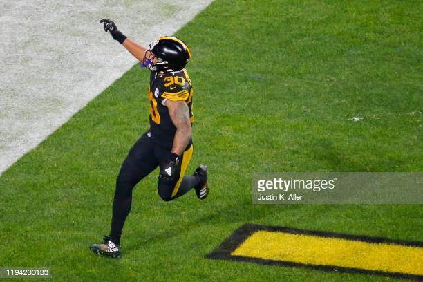 James Conner of the Pittsburgh Steelers celebrates scoring a touchdown during the third quarter against the Buffalo Bills in the game at Heinz Field...