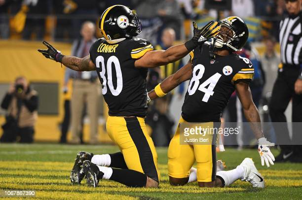 James Conner of the Pittsburgh Steelers celebrates with Antonio Brown after a 1 yard rushing touchdown during the first quarter in the game against...