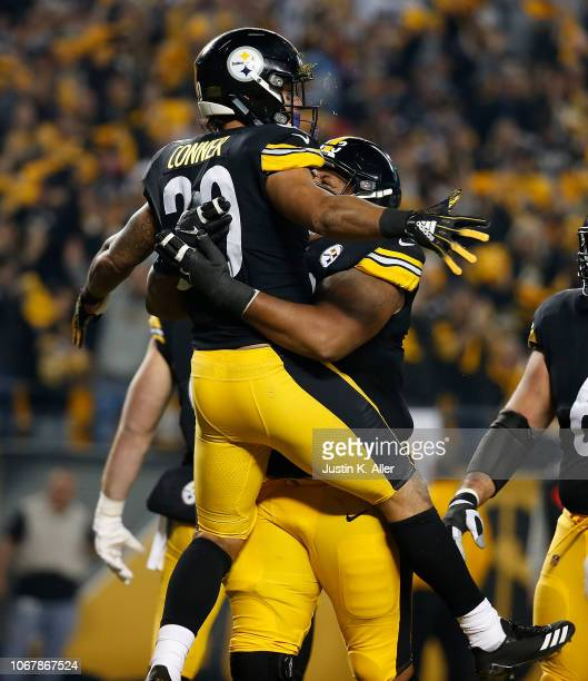 James Conner of the Pittsburgh Steelers celebrates with Ramon Foster after a 1 yard rushing touchdown in the first quarter during the game against...