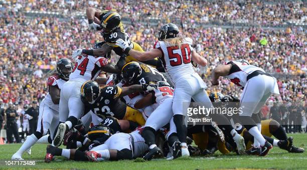 James Conner of the Pittsburgh Steelers dives into the end zone for a 1 yard touchdown in the first quarter during the game against the Atlanta...