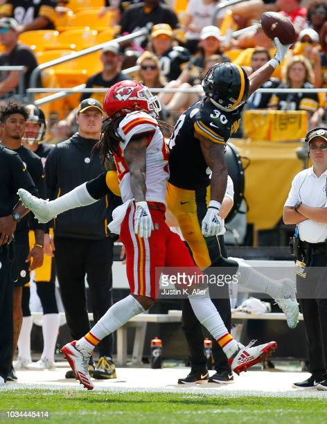 James Conner of the Pittsburgh Steelers makes a one handed catch as Terrance Smith of the Kansas City Chiefs defends in the first half during the...