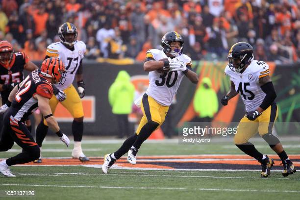 James Conner of the Pittsburgh Steelers runs the ball upfield during the third quarter of the game agains the Cincinnati Bengals at Paul Brown...