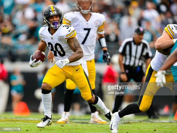 James Conner of the Pittsburgh Steelers runs with the ball during the second half against the Jacksonville Jaguars at TIAA Bank Field on November 18...