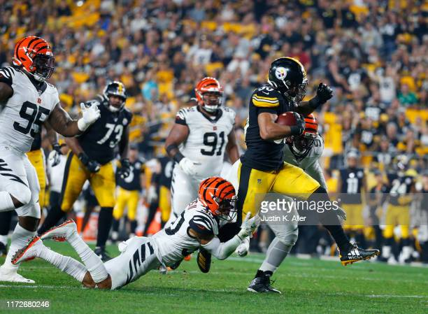 James Conner of the Pittsburgh Steelers rushes against Jessie Bates of the Cincinnati Bengals in the second half on September 30, 2019 at Heinz Field...