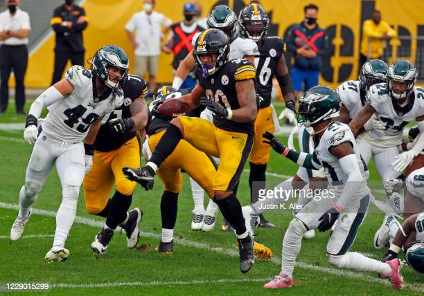 James Conner of the Pittsburgh Steelers rushes for a 1 yard touchdown in the second half against the Philadelphia Eagles on October 11 2020 at Heinz...