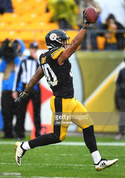 James Conner of the Pittsburgh Steelers rushes for a 22 yard touchdown during the fourth quarter in the game against the Cleveland Browns at Heinz...