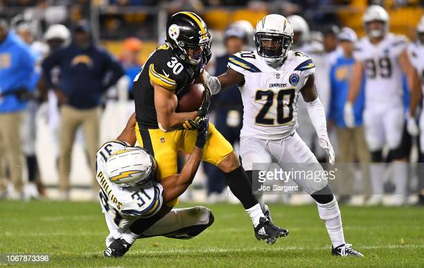 James Conner of the Pittsburgh Steelers rushes the ball against Adrian Phillips of the Los Angeles Chargers in the second half during the game at...
