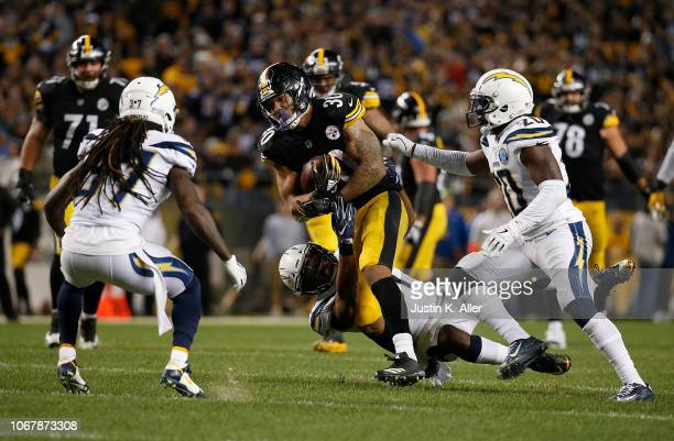 James Conner of the Pittsburgh Steelers rushes the ball against the Los Angeles Chargers in the second half during the game at Heinz Field on...