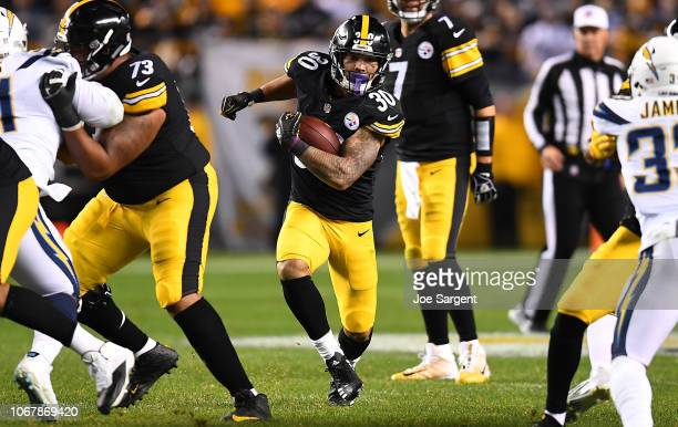 James Conner of the Pittsburgh Steelers rushes the ball in the first half during the game against the Los Angeles Chargers at Heinz Field on December...