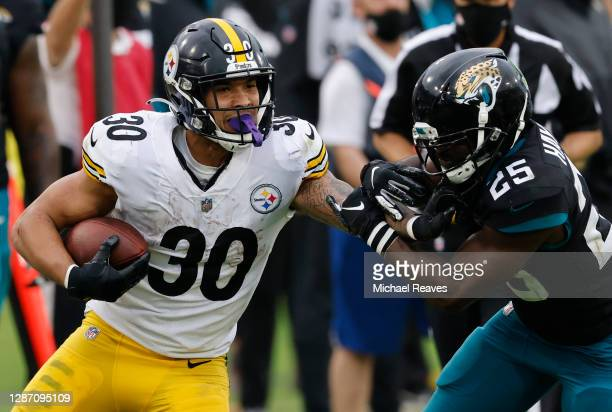 James Conner of the Pittsburgh Steelers stiff-arms D.J. Hayden of the Jacksonville Jaguars during the second half at TIAA Bank Field on November 22,...