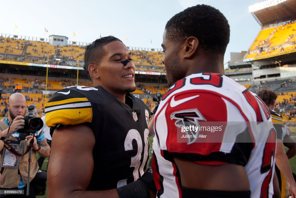 James Conner #30 of the Pittsburgh Steelers talks with Blidi Wreh-Wilson #33 of the Atlanta Falcons after defeating the Atlanta Falcons 17-13 during a preseason game at Heinz Field on August 20, 2017 in Pittsburgh, Pennsylvania.