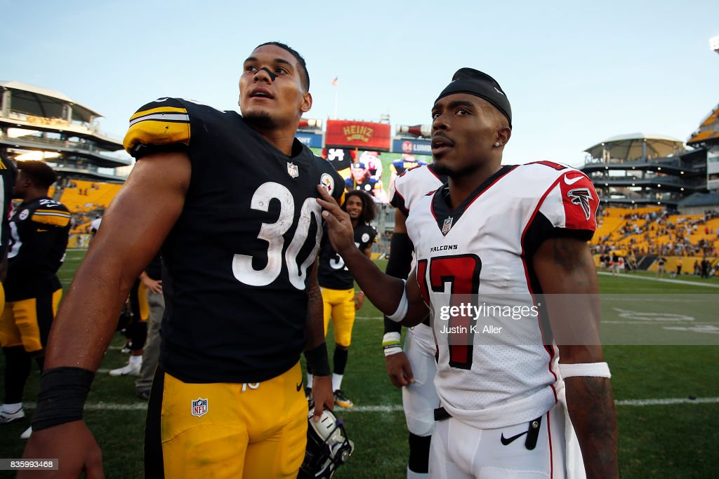 James Conner #30 of the Pittsburgh Steelers talks with Marvin Hall #17 of the Atlanta Falcons after a preseason game at Heinz Field on August 20, 2017 in Pittsburgh, Pennsylvania.